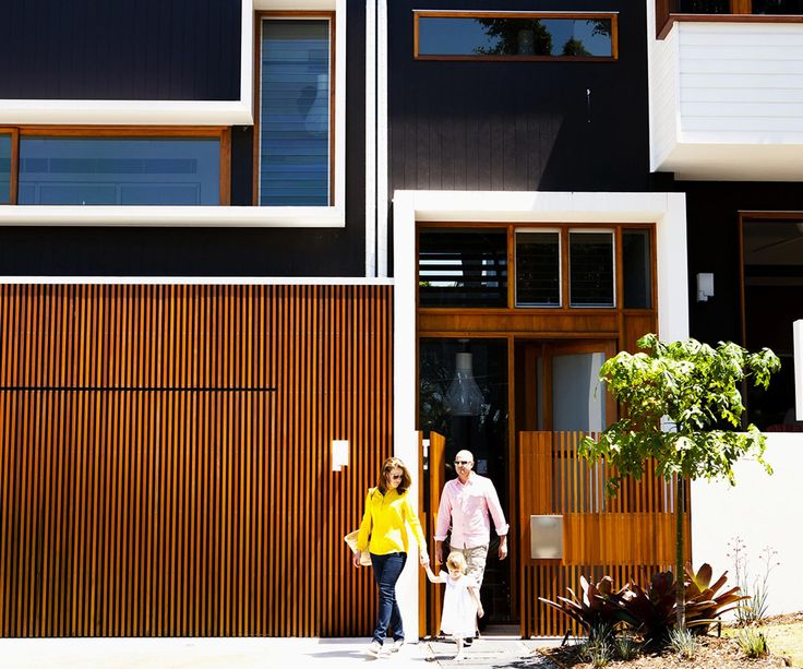 See the transformation of a small weatherboard Queenslander into a large contemporary family home with an under-house extension.