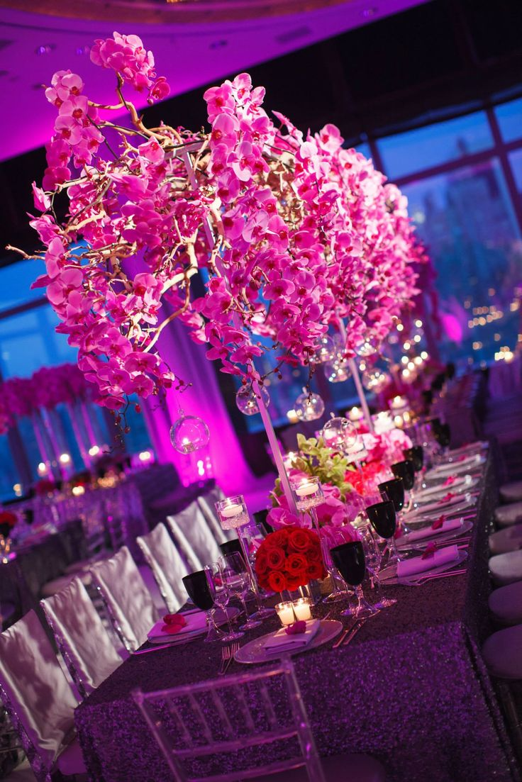 Fabulous Centerpieces At This Purple And Pink Uplighting Wedding Reception