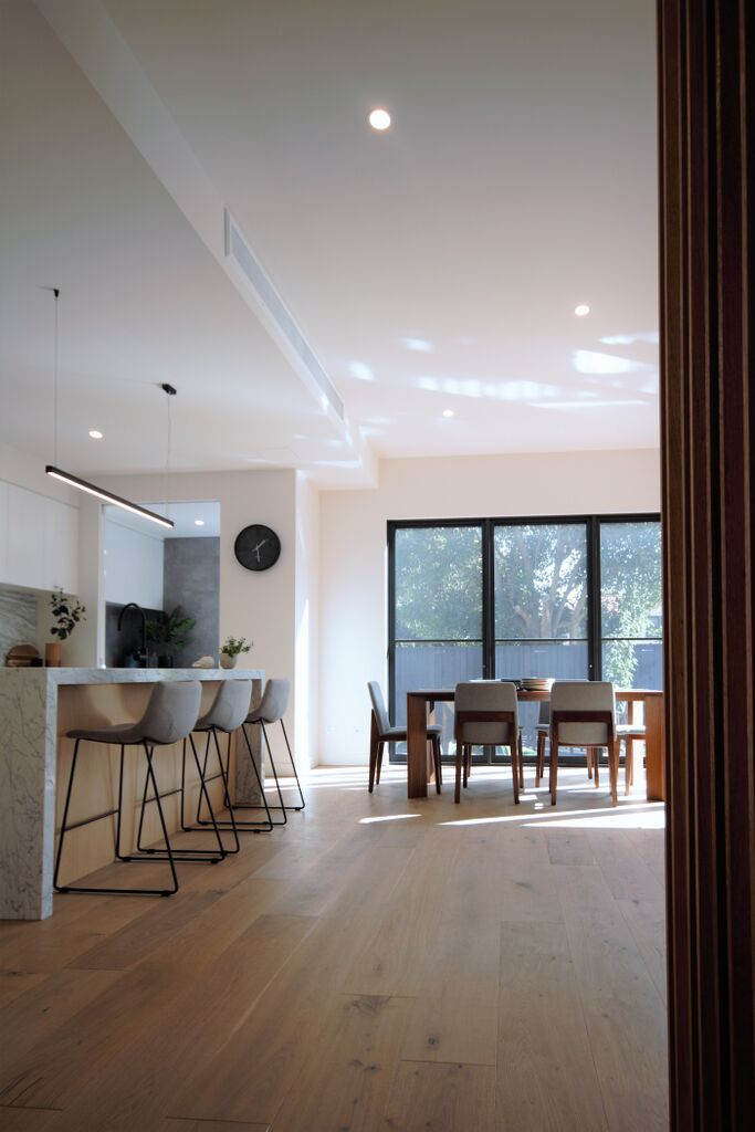 Townhouses : kitchen : Dining with pale oak floors & marble kitchen