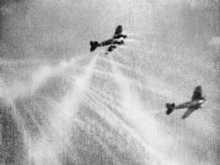 Battle of Britain 1940 - A still from camera gun film shows tracer ammunition from a Supermarine Spitfire Mark I of No. 609 Squadron RAF, flown by Flight Lieutenant J H G McArthur, hitting a Heinkel He 111 on its starboard quarter. These aircraft were part of a large formation.
