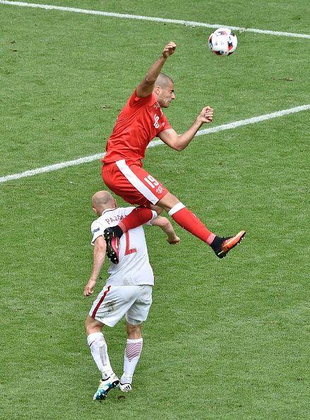 #EURO2016 Switzerland's forward Eren Derdiyok vies for the header with Poland's defender Michal Pazdan during the Euro 2016 round of sixteen football match...
