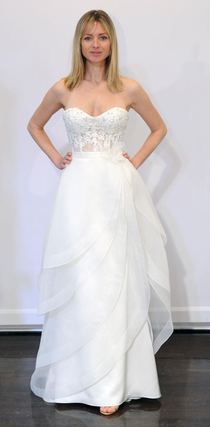 Strapless, white gown with beaded and sheer bodice | Paloma Blanca Spring 2017 | https://www.theknot.com/content/paloma-blanca-wedding-dresses-bridal-fashion-week-spring-2017