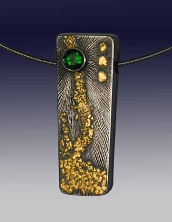 """Wolfgang Vaatz: , Pendant in sterling silver with fused CA gold nuggets and 5mm chrome diopside. 1.5mm, 16"""" oxidized sterling silver"""