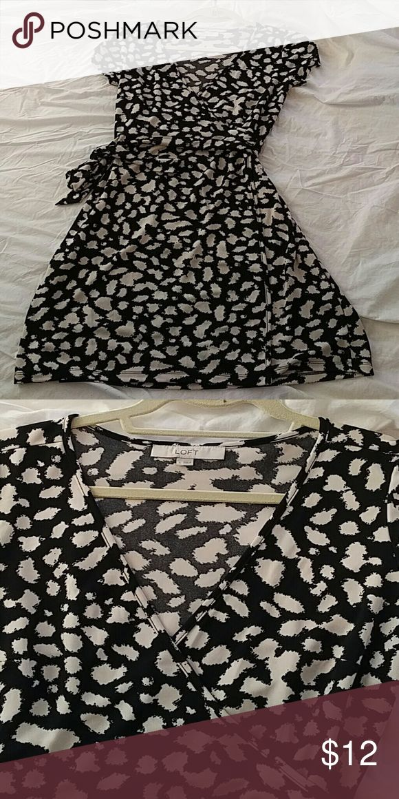 """Loft Wrap Dress Loft cap sleeve wrap dress. Machine washable, worn only once, faux animal print, black with ivory spots. Easy care, washer to dryer to balled up in a corner, it looks great for work, date night, or even running errands. Hit mid-thigh on me, but I'm 5'11"""" LOFT Dresses"""