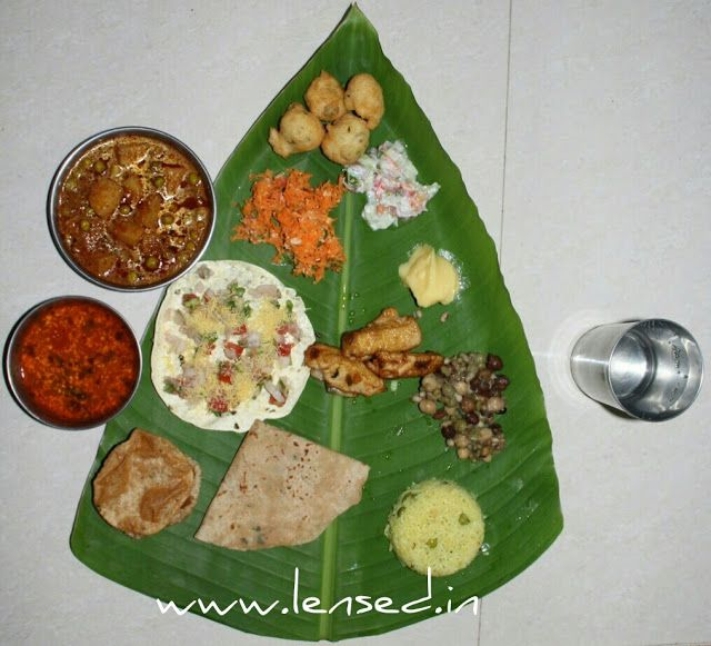 Lunch on the leaf ~ Lensed  Maharastrian lunch in India! Typical vegetarian lunch in Maharashtra, India has few main ingredients like roti (bread), curry, rice, salad, pickle, sweet, bhaji (oil fried spicy snack). The dish framed above is served on banana leaf.