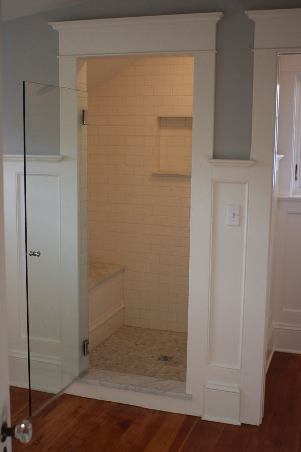 Maybe this type of framing outside the shower? Or a wood valence over curtain rod?