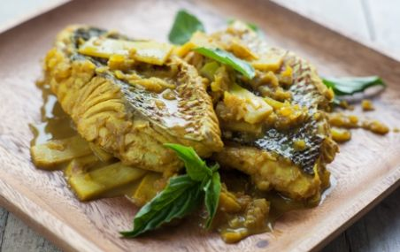 "Indonesian-Style Snapper with Tamarind-Turmeric Sauce - ""Tamarind and turmeric give a warm, tangy flavor, and coconut milk adds richness to this vibrant sauce for snapper."" 