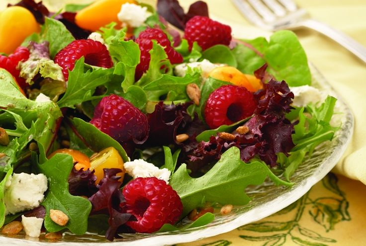Raspberry Goat Cheese Salad combines rasberries, yellow grape tomates, goat cheese, and sunflower seeds to mixed field greens, dressed with balsamic vinaigrette.  Suggested variations include using flavored goat cheese and substituting walnuts, pecans, etc.  This is a great base salad to add any preferred extras:  cukes, avocado, peppers, etc.