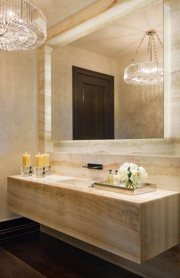 A glamorous chandelier in a very modern bath