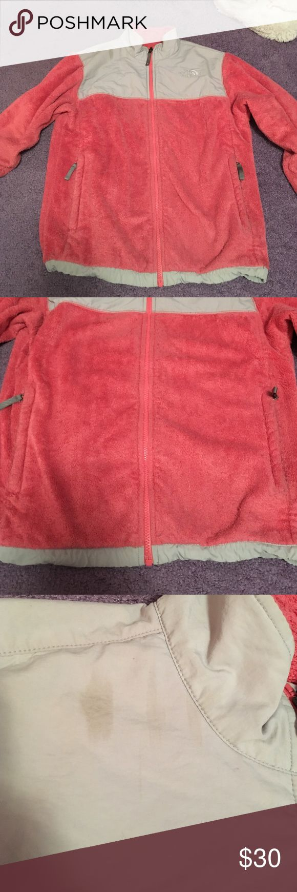 """North Face fuzzy fleece zip up Well loved pinkish orange fleece zip up. Has been worn a lot and washed before so it's far from new. It is still soft but but definitely worn and not """"fresh fuzz"""". Some discoloration spots that can be seen in the pictures as well as some pilling. Great to throw on and keep warm. Girls XL also fits women's small. Ask any question ! The North Face Jackets & Coats"""