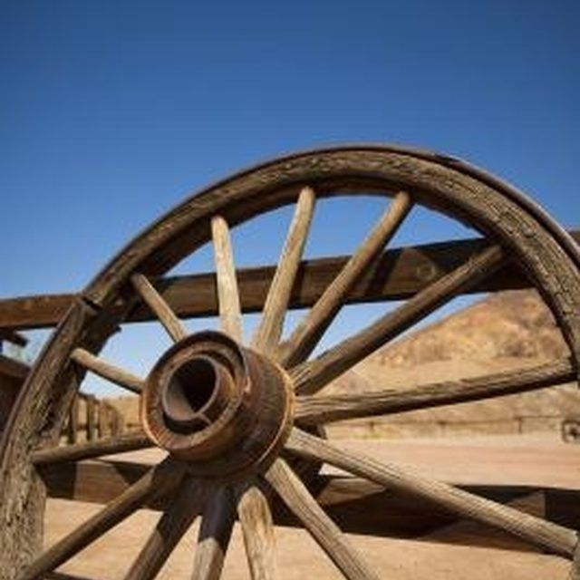 Use penetrating oil to preserve antique wagon wheels.