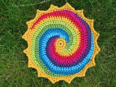Rainbow coloured spiral Mandala Wheel Pattern from: http://thecrochetcase.blogspot.co.uk/2012/03/tangles-tantrums-and-times-tables.html