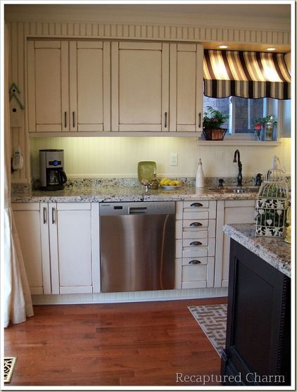 @Recaptured Charm Lisa's Bistro-style kitchen makeover is very budget friendly & #DIY. Cupboards were painted and glazed, hood range was made from scratch and the island was put together from cupboards from Home Depot.