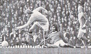 United against City 1970,George Best and Denis Law look on as Colin Bell clears the ball