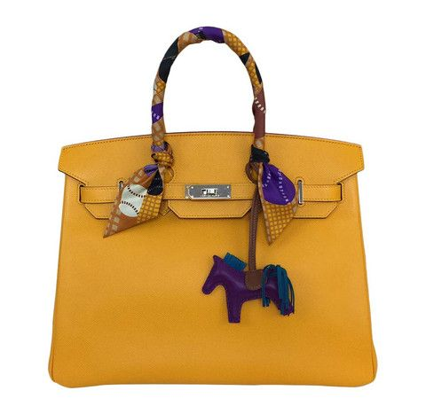 Hermes Birkin 35 featured in Jaune  d'Or. Made from Epsom leather, this bag is a true beauty.  Check out our collection! #baghunter