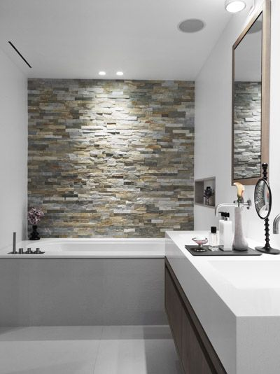 Stone Accent wall in your #Bathroom. Something to look at in the Tub! http://www.remodelworks.com/ More