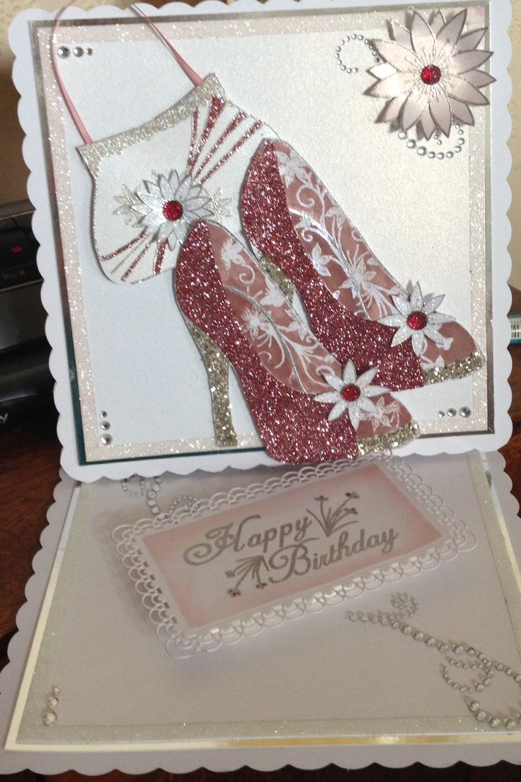 A commissioned birthday card for someone who spends all spare cash on shoes.  Stamps used are  shoe stamp, bag stamp flower stamp by Chloe's stamps.  Debbie Moore and MCS glitters, centura pearl card, gems from my stash and about 6 hours of time.