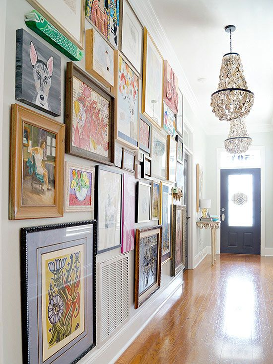 Why not take things to an entirely new level of novel with your next gallery wall project? By hanging pieces in a tight floor-to-ceiling configuration, this complex composition begs to be browsed. It's a great solution for those who have an extensive art collection that would otherwise be collecting dust in storage. /: