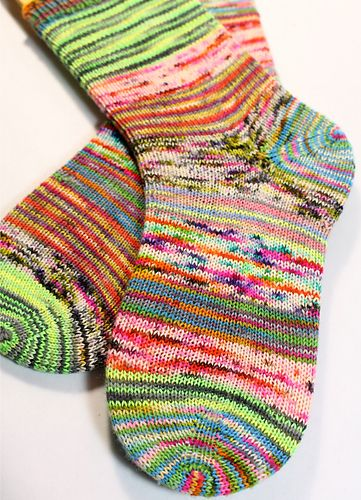 Simple toe up sock pattern using scraps of yarn tied with the magic knot.