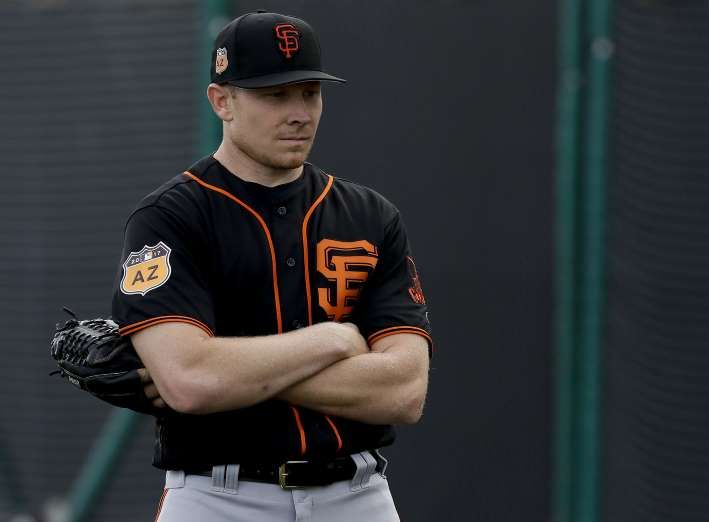 Giants-Dodgers tickets plunge to $6 after brutal start  -  April 24, 2017:     San Francisco Giants relief pitcher Mark Melancon watches during spring baseball practice in Scottsdale, Ariz., Tuesday, Feb. 14, 2017. (AP Photo/Chris Carlson)