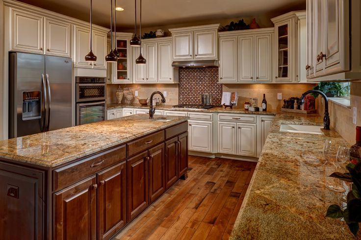 Toll Brothers - Entertain in your gourmet kitchen with granite slab countertops & KitchenAid stainless steel appliances. Bellevue kitchen