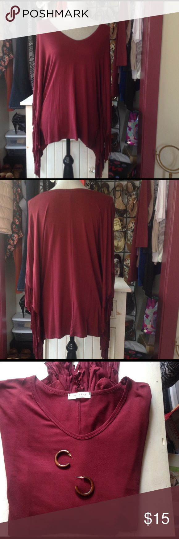 🌷🌻Beautiful Maroon Fringe Top! Gift w/purchase! Great batwing fringe top. Beautiful color. Wore this once! Great condition. Nice stretch in the material. Gift with purchase details in pic #3. Promesa Tops