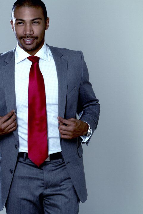 "Charles Michael Davis, Marcel Gerard from the sitcom "" The Originals"". That red tie really finishes his suit off. ☺"