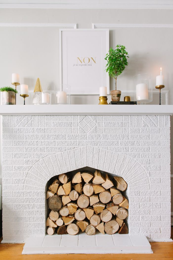 fireplace + mantle via @Danielle Lampert Lampert Moss. Don't leave your summer fireplace a black empty cave. Fill it.: Mantels, Fireplaces Mantles, Living Rooms, Idea, Wood, Logs, Fireplaces Fillers, Brick Fireplaces, Faux Fireplaces