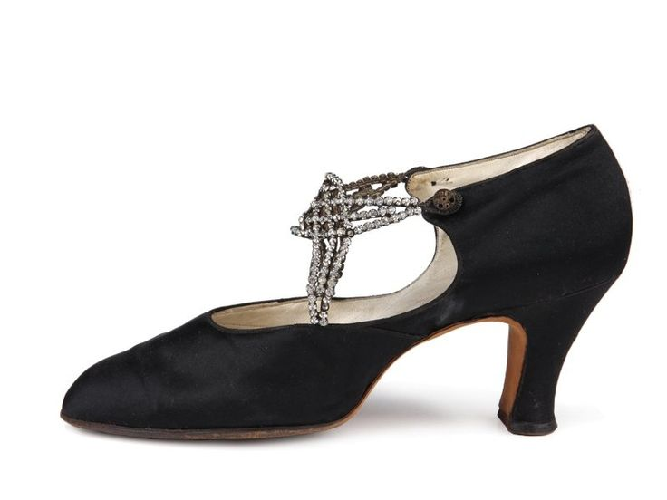 1920s D'Orsay black satin pumps with straps formed by rows of rhinestones in bezels closing on two buttons.