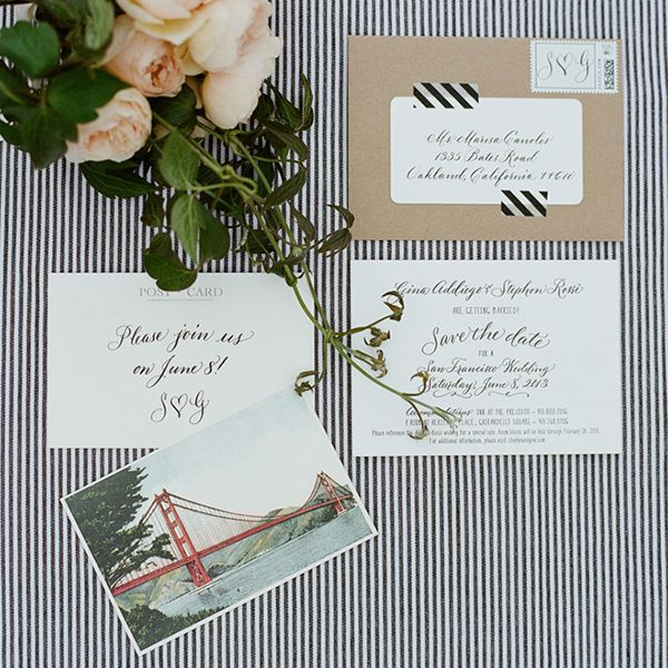 Black, white invites with kraft paper envelopes and stripes washi tape