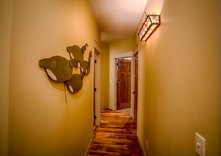 Hallway. Antique goose decoys. Acacia hardwood floors.,