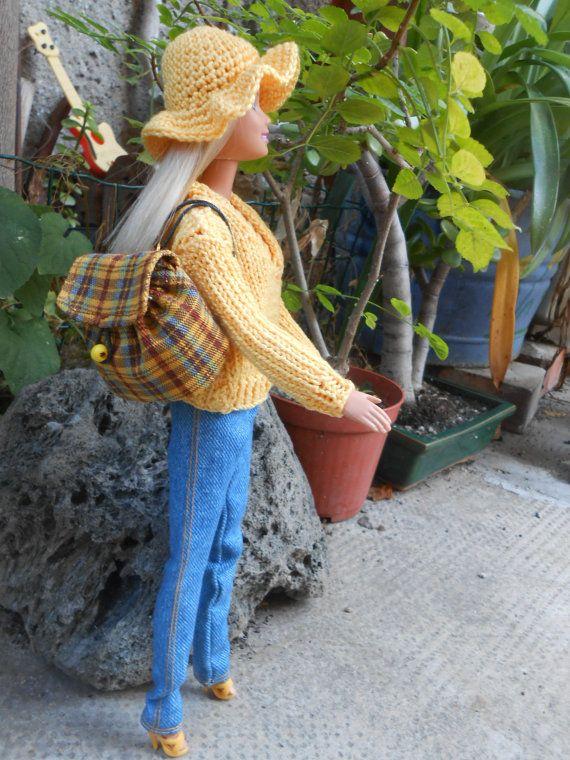Barbie con abiti fatti a manomaglia gialla ai di lepropostedimari