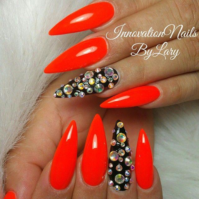 Bright red stiletto nails