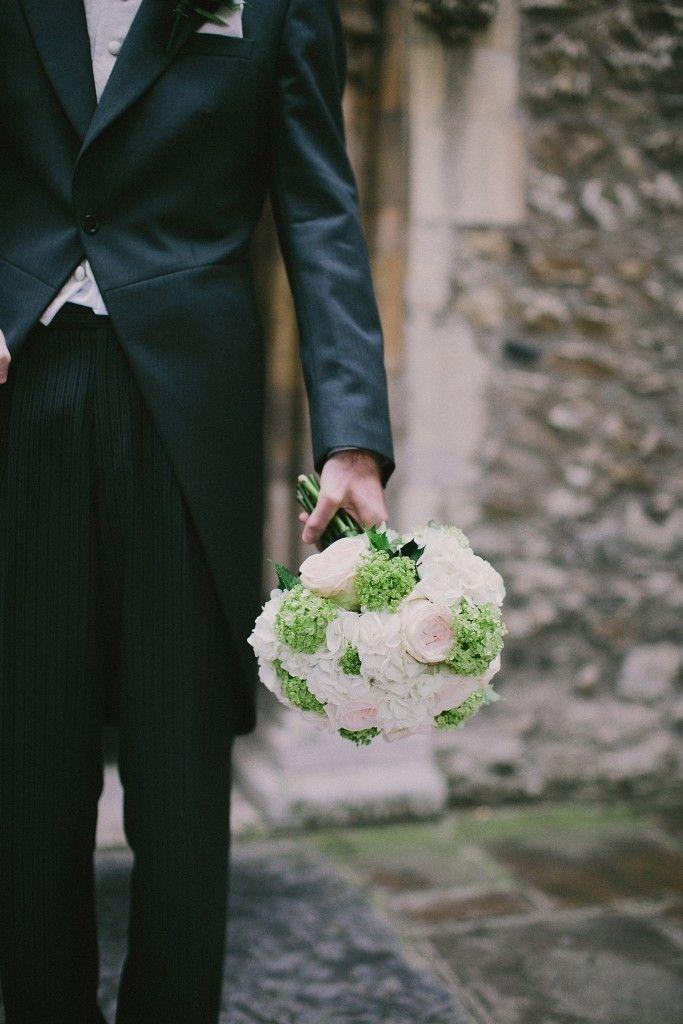 nicholau-nicholas-lau-interracial-wedding-groom-black-suit-holding-the-bouquet