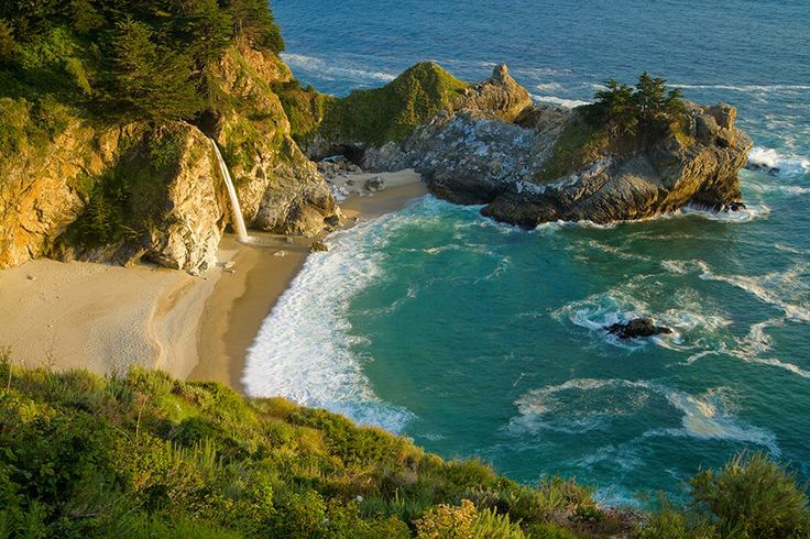 McWay Falls, which drops over a cliff 24 m into the Pacific Ocean, Julia Pfeiffer Burns State Park, California, USA. One of a few that falls into the ocean, it's an incredibly scenic waterfall along the beach in a cove.
