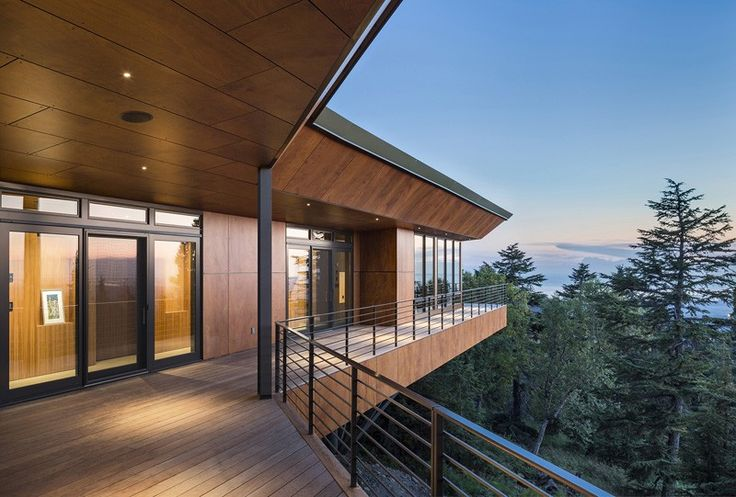 House On A Hillside Among The Trees View