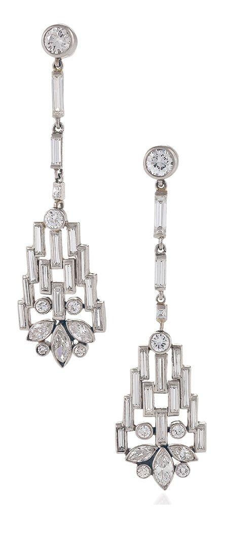 Boucheron Paris - A pair of Art Deco diamond and platinum earrings, 1920s. Signed Boucheron Paris. Length: 1-3/4 inches. #Boucheron #ArtDeco
