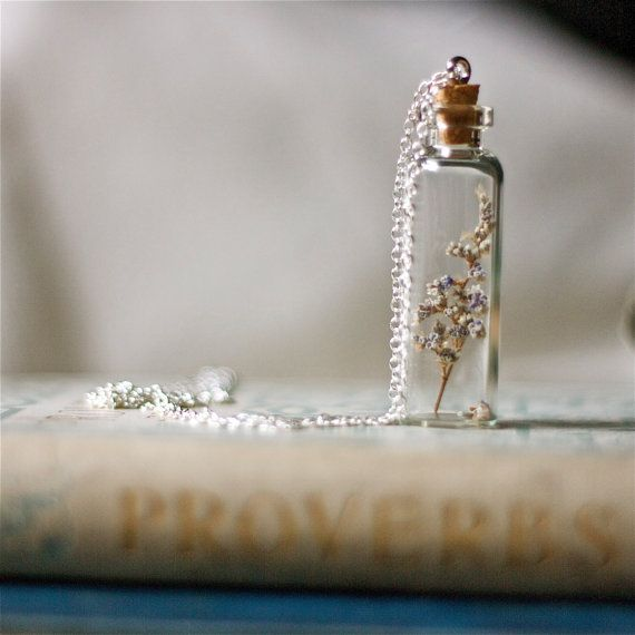 I love this- tiny wildflowers bottled up and turned into pretty jewelry- definitely a potential DIY craft