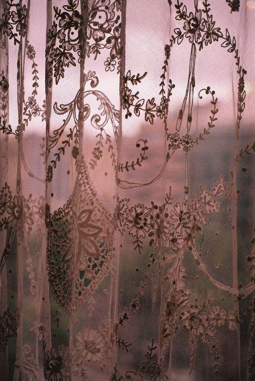 An evening sunset through lace curtains