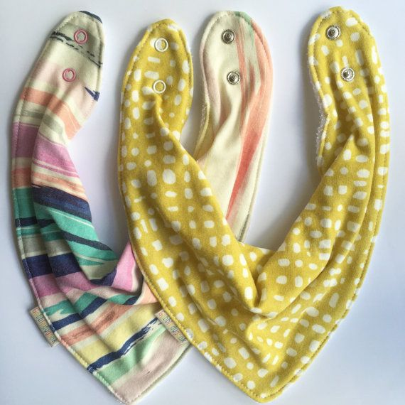 a gorgeous pair of bambood dribble bibs donating 20% of sale proceeds to that the beneficiaries of Because I Am A Girl programs can have a brighter future. Set of 2 Comfort Fit Bandana Bibs by GobbledygookStudio on Etsy