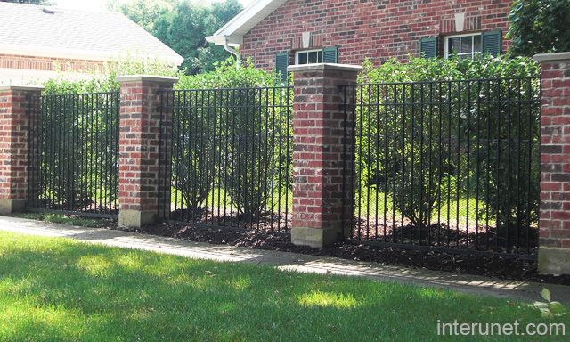 Metal fence with privacy bushes