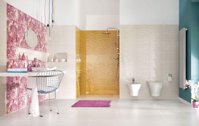 Jako baza – wyraziste, kolorowe fale: białe, żółte, bordowe i indygo. Jako dekoracja: trzy rodzaje kwiatowych dekoracji. Połączenie tych dwóch składowych sprawi, że wnętrze nabierze ciepłego i przytulnego charakteru. http://www.paradyz.com/plytki/lazienkowe/manarola-mano https://www.facebook.com/CeramikaParadyz