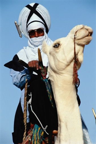 Badass Tuareg chieftain on white camel