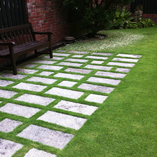 stone set in grass makes a nice sitting or patio area