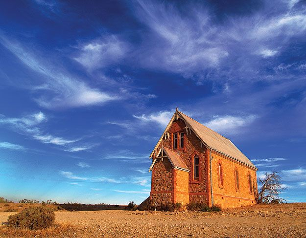 """An Australian Outback Church:  """"I love a sunburnt country, A land of sweeping plains, Of ragged mountain ranges, Of droughts and flooding rains. I love her far horizons, I love her jewel-sea, Her beauty and her terror The wide brown land for me!"""" Australian poet & author Dorothea MacKellar (1883-1968)."""
