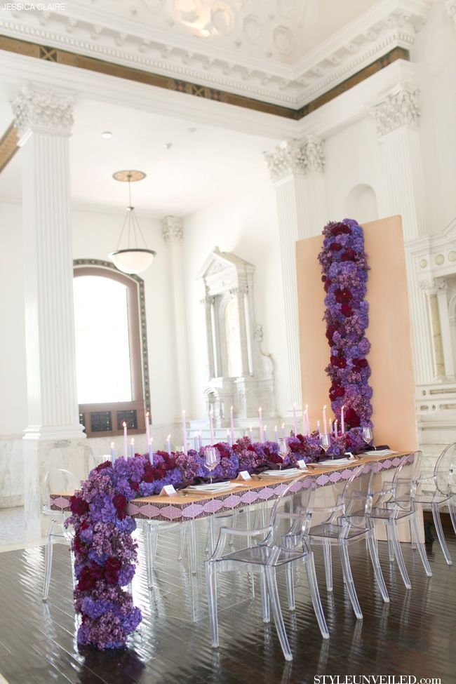 wedding table garland with cascading purple flowers and candles
