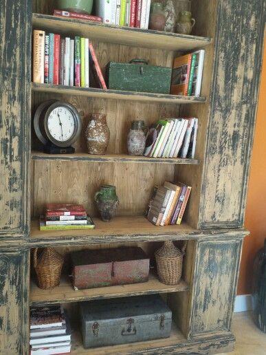 Book shelf in entry way at Tastings Room