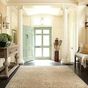 Hudson Interior Designs - entrances/foyers - traditional entryway, formal entryway, greek columns, seafoam green front door, green front door, vintage oars, umbrella stand, dark stained floors, ebony stained doors, limed console table, traditional console table, gilt mirror, traditional wall sconces, bench seating, entryway bench, geometric pillo, gray persian rug, pale gray persian rug, white spindles, stained stair treads, caramel wall color, wainscotting, millwork, mint green, mint green…