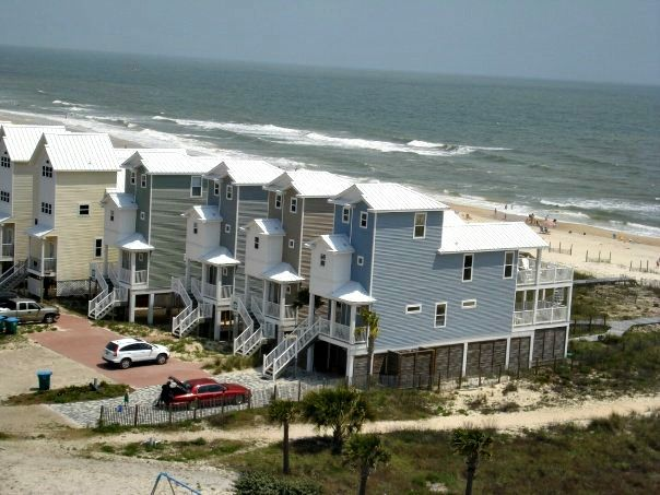 Beach houses on quiet St. George Island.  Interested in relaxing in one of these beachfront rentals? Click here for accommodations: http://collinsvacationrentals.com/