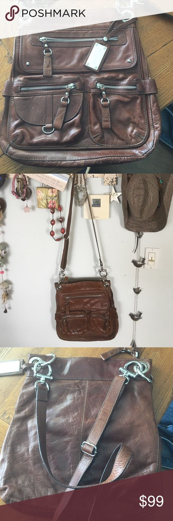 Brown leather cross body, 🇬🇧Autograph collection This bag is a timeless rich luxurious brown leather purchased in Great Britain Marks & Spencers Autograph collection retailing for around $190 its hardware is a fabulous silver polished look. I will add 4 additional pics on separate listing. Used few times condition is excellent. Strap can be shortened for shoulder lookor crossbody. Marks & Spencers Autograph Bags Crossbody Bags